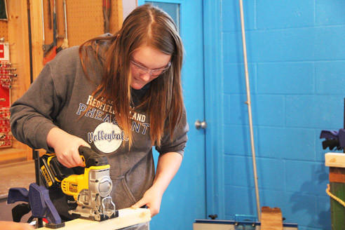 Karrie Stickler, a senior at Doland School, works on a project in the school's shop area during agriculture class. The program was re-established recently after a 13-year hiatus.