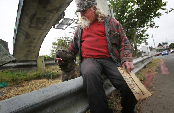 A 2011 report by the National Law Center on Homelessness and Poverty found that more than 100 cities had some kind of restriction on panhandling; 16 of those were in California. Above: Big Al sits on a guardrail with his pet mastiff on June 20, 2012 in Arcata.