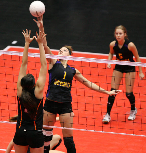 Herreid/Selby Area's Haylee Biel, center, tries to tip the ball past Faith's Marissa Collins, left, during Friday morning's consolation round match at the South Dakota Class B State Volleyball Tournament in Sioux Falls. photo by john davis taken 11/18/2011