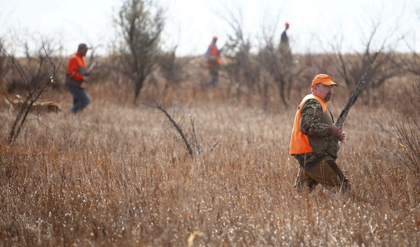 Pete Kemp, of Lodi, Wisc., right, walks a public hunting ground southwest of Aberdeen with the rest of his party. photo by john davis taken 10/20/2012