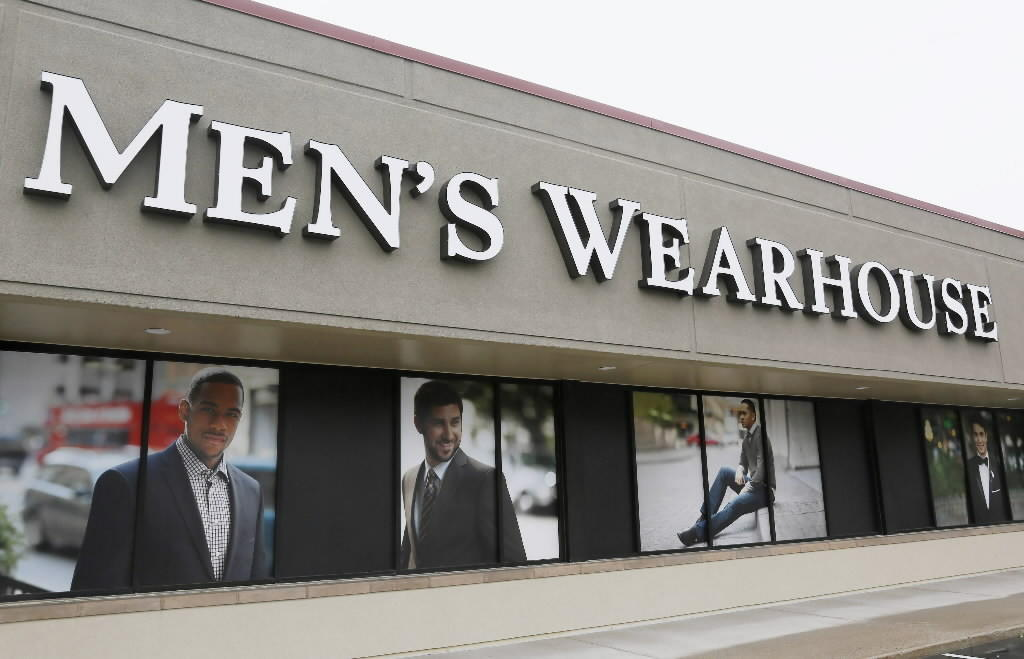 The Men's Wearhouse sign is seen outside its store in Westminster, Colorado September 11, 2013.