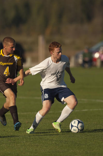 Petoskey senior Ethan Cartwright (right) scored three goals including the opening goal and game winner as the Northmen rolled past West Branch Ogemaw Heights, 8-0, Tuesday in a Big North Conference match at the Click Road Soccer Complex.