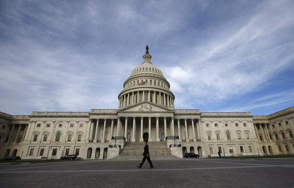 A lone worker passes by the U.S. Capitol Building in Washington.