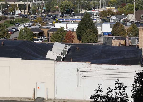 Portions of a roof in a Mount Prospect building collapsed on Tuesday, leading officials there to close two lanes of Northwest Highway.
