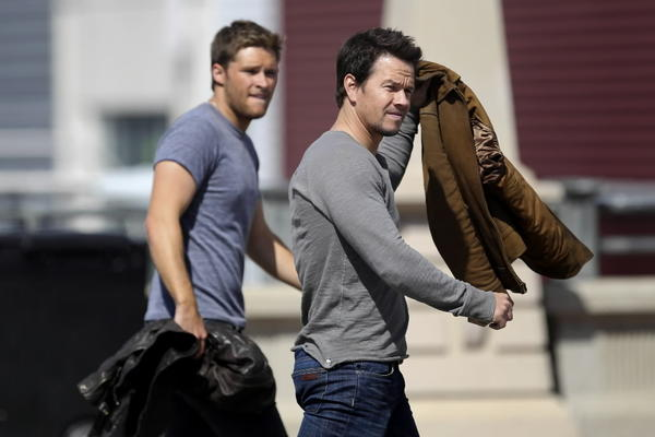 """Actors Mark Wahlberg (right) and Jack Reynor (right) wrap up filming a scene of """"Transformers: Age of Extinction"""" on West Roosevelt Road between South Delano Court and South Canal Street Sept. 14, 2013."""