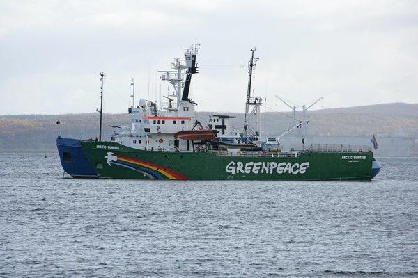 The Arctic Sunrise, a Greenpeace ice breaker, is towed by a Russian coast guard ship in September.
