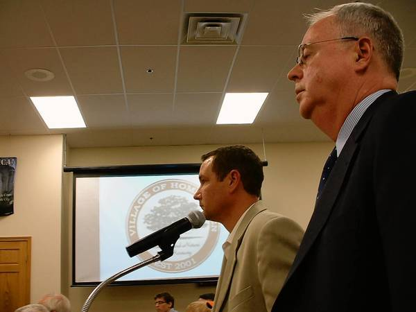 Tom Wallace, general manger of operations for Dotty's in Illinois, left, and Terence Dunleavy, an attorney representing Dotty's, speak at the Oct. 8 Village Board meeting. Also at the meeting, trustees approved requiring a permit to burn leaves.