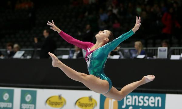 Italy's Carlotta Ferlito competes on the balance beam during a qualification session at the world championships in Antwerp, Belgium.