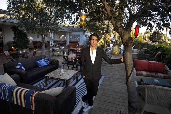 Brent Bolthouse stands on the patio of The Bungalow in Santa Monica.