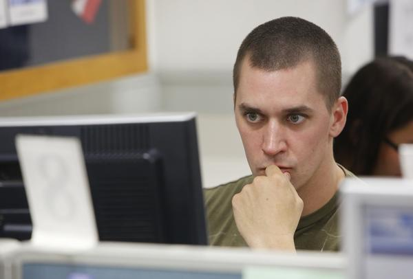 Jeremy Taylor, who recently left the Air Force, searches for jobs at the California Employment Development Department office in Sacramento.