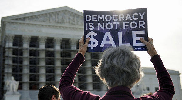 People protest during oral arguments in the case of McCutcheon v. Federal Election Commission at the US Supreme Court in Washington, D.C.