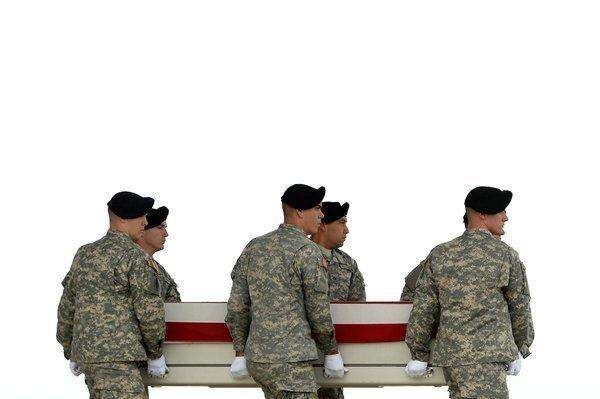U.S. Army soldiers carry the flag-draped transfer case containing the remains of U.S. Army Pfc. Cody J. Patterson at Dover Air Force Base in Delaware.