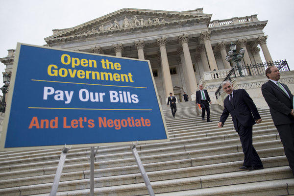 Lawmakers arrive for a news conference on the ongoing budget battle Wednesday in Washington.