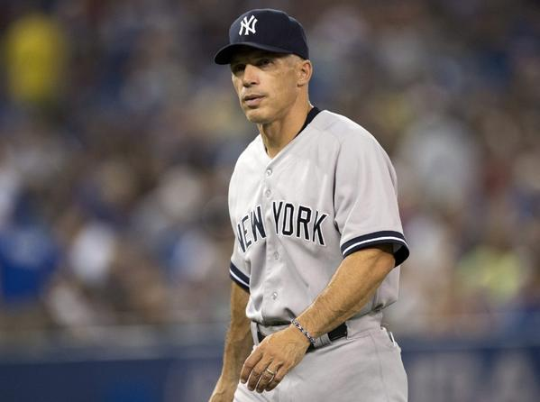 Joe Girardi accepted a four-year contract to remain as manager of the Yankees, the team announced Wednesday.