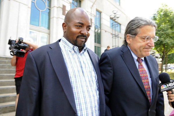 Dr. Tory Z. Westbrook (left) leaves Middletown Superior Court with his attorney, Norman Pattis, in July 2012.