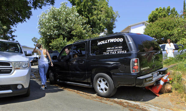 A Hollywood SUV limo backs over parking cones as traffic comes to a stop on the  hills overlooking the Hollywood sign in Los Angeles in July 2011.