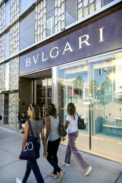 Shoppers pass the Bvlgari boutique, one of the sites participating in the Rodeo Drive Festival of Watches.