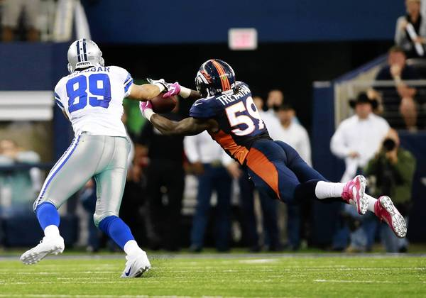 Oct 6, 2013; Arlington, TX, USA; Denver Broncos outside linebacker Danny Trevathan (59) intercepts a pass in front of Dallas Cowboys tight end Gavin Escobar (89) in the fourth quarter of the game at AT&T Stadium. The Denver Broncos beat the Dallas Cowboys 51-48. Mandatory Credit: Tim Heitman-USA TODAY Sports ORG XMIT: USATSI-132702