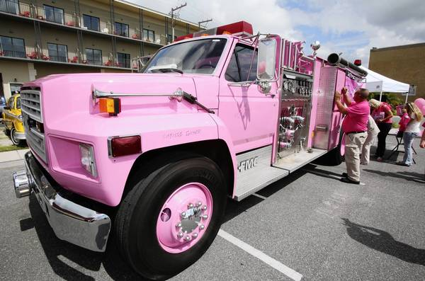 A Lake County Professional Firefighters' pink fire truck was dedicated on Tuesday, October 8, 2013 in Tavares, in support of Breast Cancer Awareness Month.