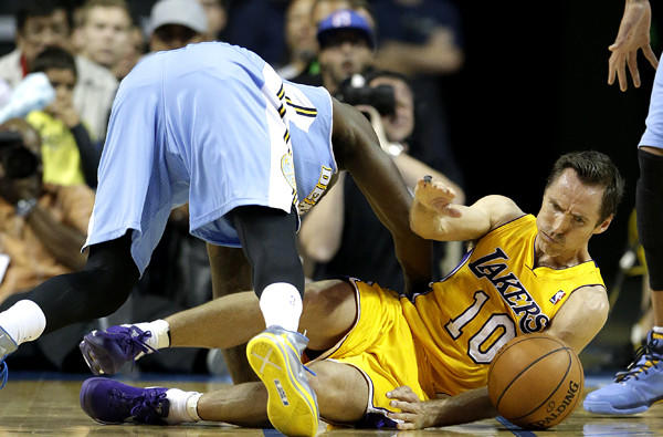 Lakers point guard Steve Nash and Nuggets guard Randy Foye battle for a loose ball during a preseason game Tuesday.