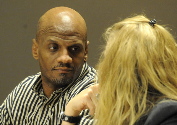 James Ealy, 48, of Lake Villa talks to public defender Jennifer Snyder during his sentencing at the Lake County Courthouse in Waukegan, Ill. today. Ealy was sentenced to natural life in prison for first-degree murder in the strangulation death of Mary Hutchison, of Trevor, Wis., at the Burger King restaurant in Lindenhurst on November 27, 2006.