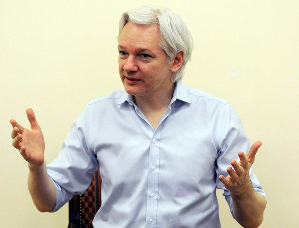 Wikileaks founder Julian Assange speaks to the media inside the Ecuadorian Embassy in London in June 2013.