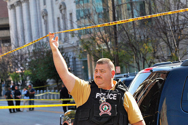 A deputy secures an area in front of the federal building in Wheeling, W.Va., after a shooting.
