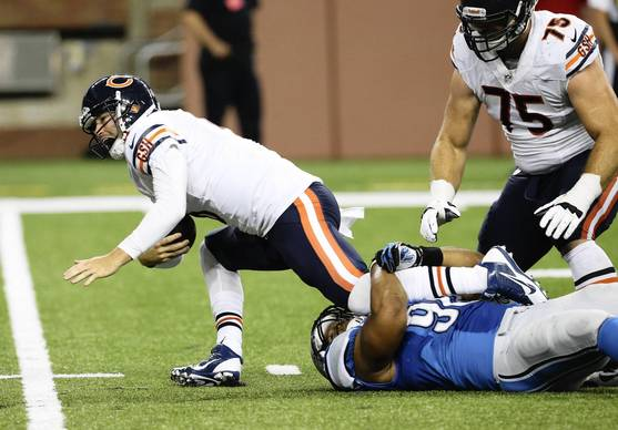 Chicago Bears quarterback Jay Cutler (6) is sacked by Detroit Lions defensive tackle Ndamukong Suh (90) during the first half.