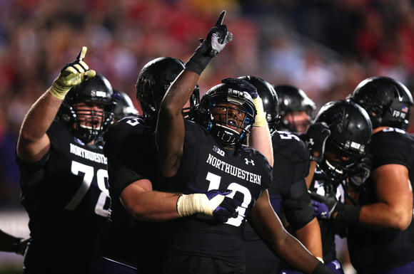Northwestern football players celebrate