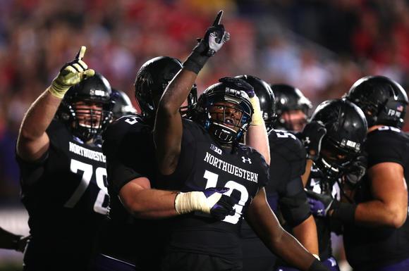 Northwestern football players celebrate
