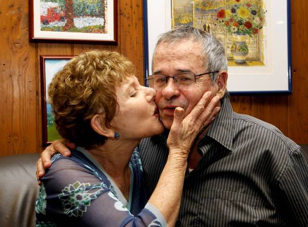 USC chemistry professor Arieh Warshel gets a congratulatory kiss from his wife, Tami, at their Los Angeles home after he learned he and two colleagues had been awarded the Nobel Prize in chemistry.