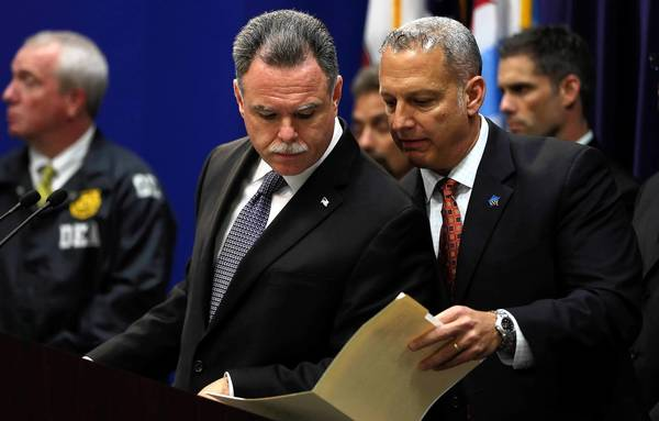 Chicago Police Superintendent Garry McCarthy, left, confers with Nicholas J. Roti, chief of the Chicago Police Bureau of Organized Crime, at Wednesday's news conference announcing the crackdown on the Imperial Insane Vice Lords.