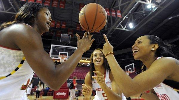 University of Maryland womens basketball players A'Lexus Harrison, Malina Howard and Brene Moseley try spinning a basketball on their fingers at media day at the Comcast Center.