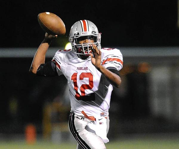 Parkland's Devante Cross (right) looks for an open receiver during their Lehigh Valley Conference football game with Liberty High School on Friday, September 20, 2013.