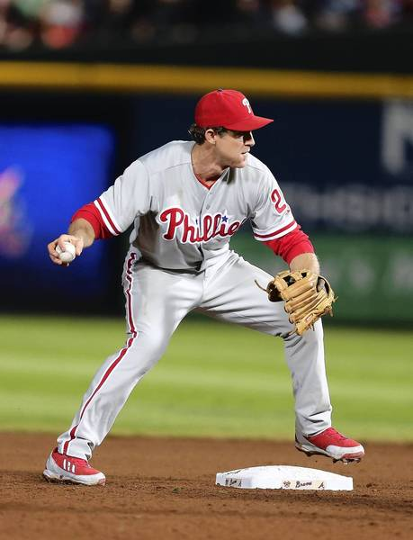 Second baseman Chase Utley #26 of the Philadelphia Phillies turns a double play during the game against the Atlanta Braves at Turner Field on September 28, 2013 in Atlanta, Georgia.