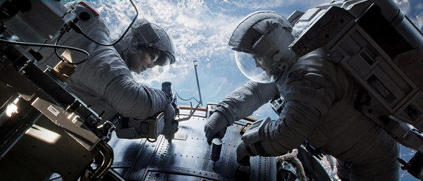 "Sandra Bullock, left, as Dr. Ryan Stone and George Clooney as Matt Kowalsky in ""Gravity,"" which has given the 3-D format a boost."