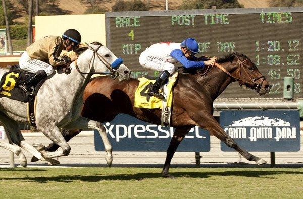 No Jet Lag (4) and jockey Mike Smith hold off He Be Fire N Ice and jockey Victor Espinoza, to win the City of Hope Mile Stakes on Saturday at Santa Anita Park.