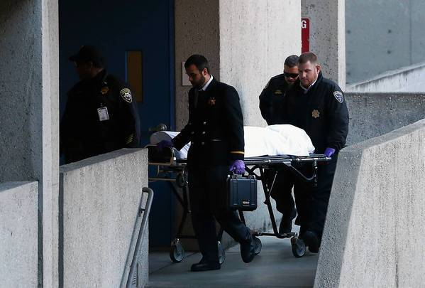 Officials remove the body of 57-year-old Lynne Spalding, found Tuesday in a stairwell at San Francisco General Hospital and Trauma Center 17 days after she was reported missing from her bed at the hospital.