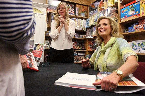 Ann Romney signs copies of her cookbook entitled Ann Romney Family Table at the Flintridge Bookstore in La Canada Flintridge on Tuesday, October 8, 2013. Romney's communications director Leah Malone stands behind her.