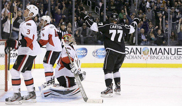 Jeff Carter celebrates after scoring the game-winning goal in overtime to give the Kings a 4-3 victory over the Ottawa Senators.