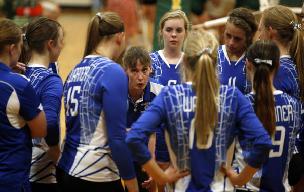 Warner volleyball coach Kari Jung, center, talks to her players during a time out in a match against Northwestern earlier this season. Warner, the unbeaten top-ranked team in Class B meets Sioux Falls OGorman, the unbeaten top-ranked team in Class AA in a tournament in Chester on Saturday.