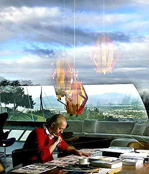 Taschen often works at home; the large amount of glass reflects clouds and sky indoors.