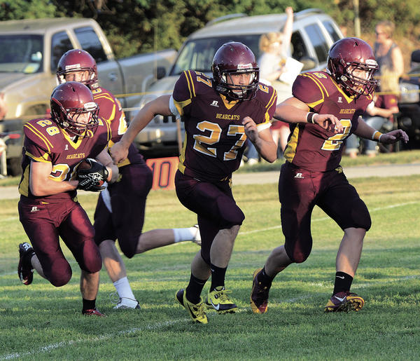 Webster quarterback Reid Valsvig hands off to Austin Grout with blockers Nolan Richie (27) and Tyler Wagner (2) in front of him. Webster will host Clark-Willow Lake at 7 p.m. Friday in the Game of the Week.