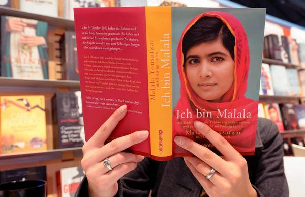"A visitor reads the book ""Ich bin Malala"" (I am Malala) from Malala Yousafzai at the 2013 Frankfurt Book Fair in Germany on Wednesday."