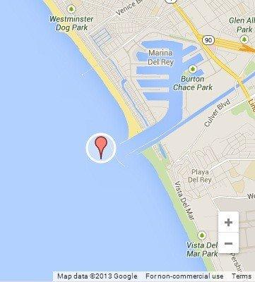 Two men were rescued near Marina del Rey after their boat capsized just outside the marina breakwater.