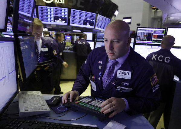Specialist John Parisi works at his post on the floor of the New York Stock Exchange on Wednesday.