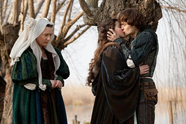 """Douglas Booth, right, and Hailee Steinfeld, center, in a scene from """"Romeo and Juliet."""""""