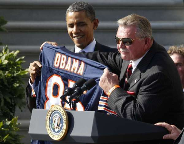 Mike Ditka, right, said he wished he had run against Barack Obama in 2004 for U.S. Senate in Illinois, because it could have meant Obama wouldn't be in the White House today.