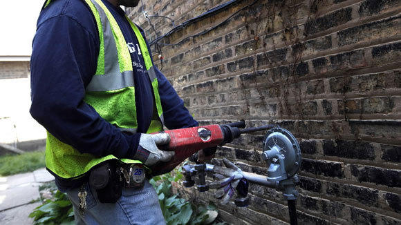 Peoples Gas installs a medium pressure regulator in a home on the Northwest Side in a 2012 file photo.