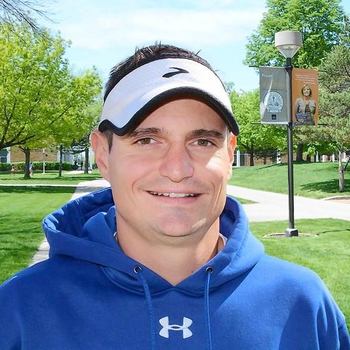 Nick Schneigert will coach track at Triton College.
